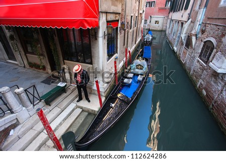 Quiet Venice with alone Gondolier in Italy - stock photo
