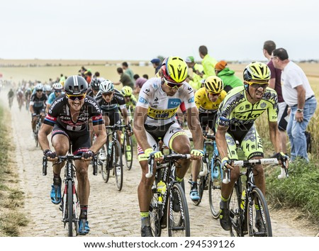 QUIEVY,FRANCE- JUL 07:Big favorites of Le Tour de France 2015 (Contador,Sagan,Froome,Degenkolb,Martin,and Nibali) riding on a cobblestone road during the stage 4 in Quievy, France, on 07 July - stock photo