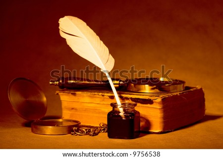 Quill, inkwell, compass, book with an antique look - stock photo