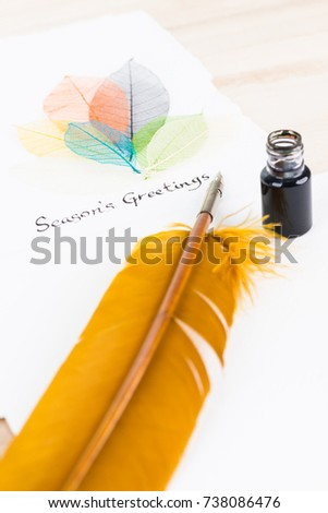Quill Pen and Season's Greetings message on cotton paper