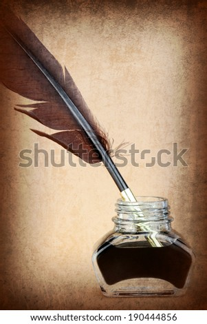 Quill pen in ink bottle on brown background. Vintage style image. - stock photo