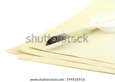Quill pen on papers - stock photo