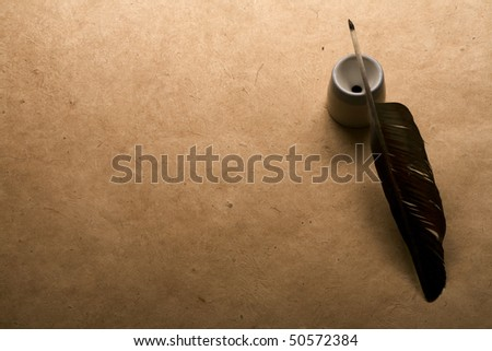 quill pen on vintage paper background - stock photo