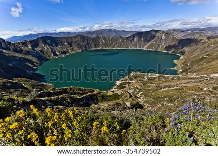 Quilotoa crater lake with flowers in Ecuador, Cotopaxi, Ecuador