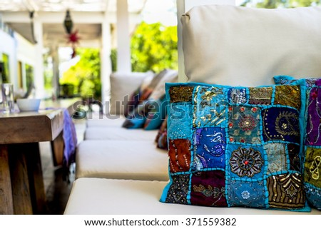Quilted blue cushion in sofa in outdoor patio - stock photo