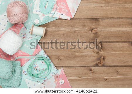 Quilting, Sewing, Knitting And Crochet Accessories. Fabric, Yarn Balls, Threads. Wooden Table. Copy Space - stock photo