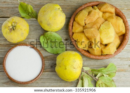 Quince fruits and quince paste ingredients on wooden background - stock photo