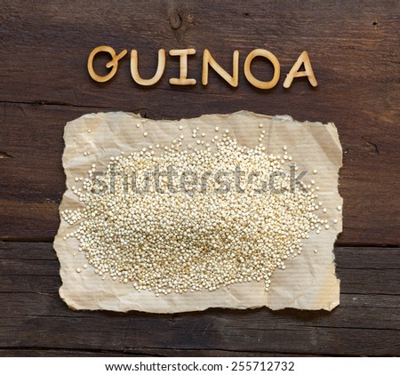 Quinoa and a  word Quinoa on a wooden table - stock photo