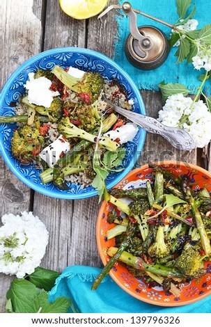 quinoa and broccoli salad on the ornamental plate - stock photo