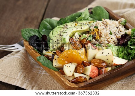 Quinoa, avocado and apple salad. Perfect for the detox diet or just a healthy meal. Selective focus with extreme shallow depth of field.   - stock photo