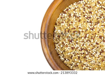 Quinoa bulgur mix in a wooden bowl isolated on white  - stock photo