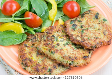 Quinoa fritters with vegetable salad - stock photo