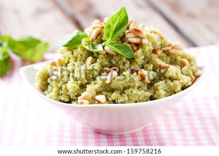 Quinoa meal with pine nuts and fresh basil - stock photo