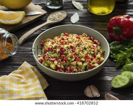 quinoa salad with vegetables for lunch on wooden table - stock photo