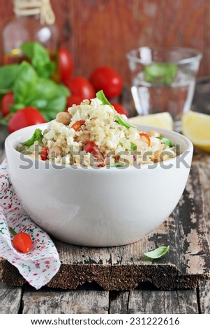 Quinoa salad with vegetables mix, chickpea and cheese.Selective focus. - stock photo