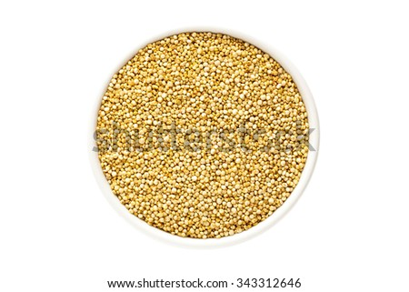 Quinoa seeds in a cup from above isolated on white background - stock photo