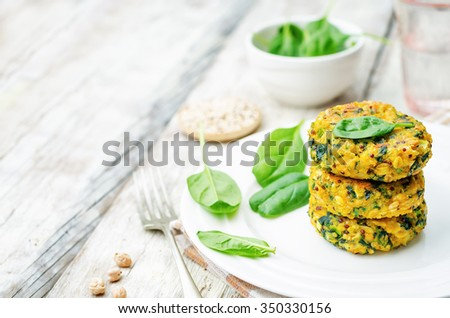 quinoa spinach chickpeas pumpkin fritters on white wood background. toning. selective Focus - stock photo