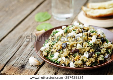 quinoa spinach eggplant feta salad on a dark wood background. the toning. selective focus - stock photo