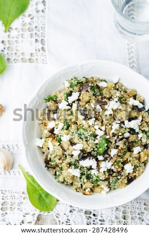 quinoa spinach eggplant feta salad on a white background. the toning. selective focus - stock photo