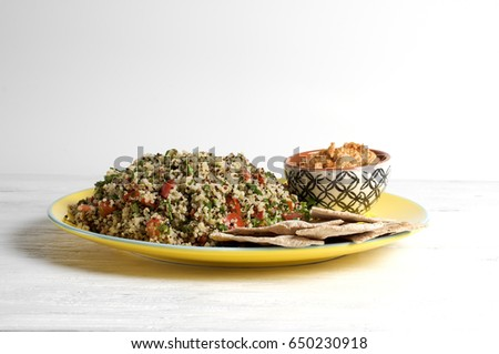 Quinoa tabbouleh with hummus and pita triangles