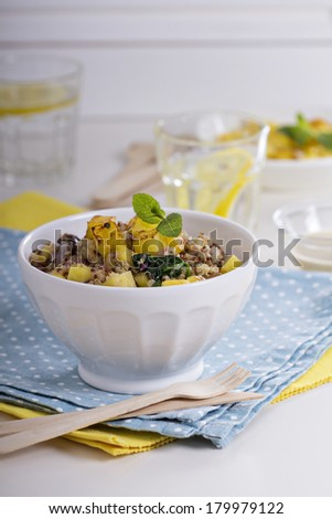 Quinoa with mushrooms, onions, spinach and pineapple - stock photo