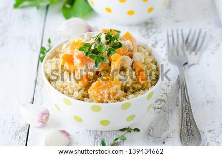 Quinoa with pumpkin. Selective focus - stock photo