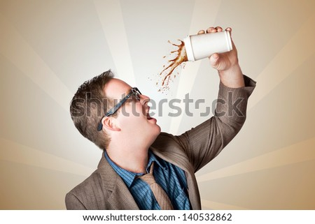 Quirky nerd business man in the throes of a coffee splash and dash. Quick coffee on the go - stock photo