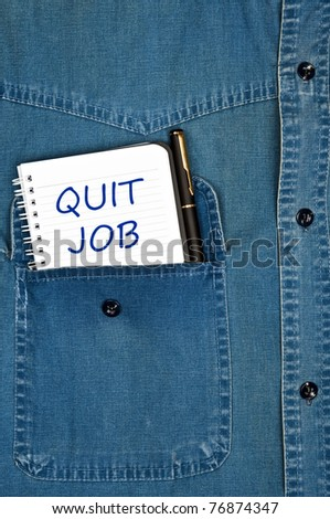 Quit job message on notepad - stock photo
