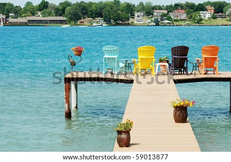 quite dock with colorful chairs and decorations - stock photo