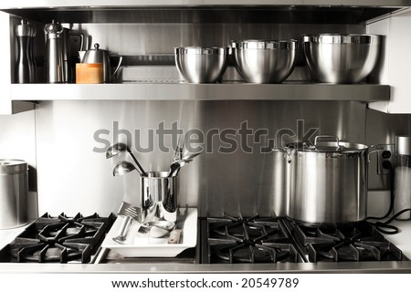 quite new kitchen stuff in silver black colors - stock photo