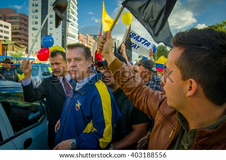 Quito, Ecuador - April 7, 2016: Closeup opposition leader Andres Paez surrounded by people during anti government protests in Shyris Avenue
