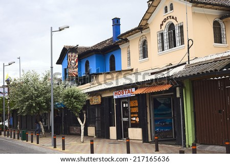 """QUITO, ECUADOR - AUGUST 6, 2014: Hostal """"El Viajero Feliz"""" (The Happy Traveller) and the """"Ace of Spades"""" Bar on Jose Calama Street in the tourist district on August 6, 2014 in Quito, Ecuador - stock photo"""