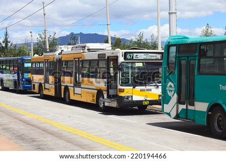 QUITO, ECUADOR - AUGUST 8, 2014: Trolleybus of the local public transportation system standing outside the Quitumbe Terminal Terrestre (long-distance bus terminal) on August 8, 2014 in Quito, Ecuador - stock photo
