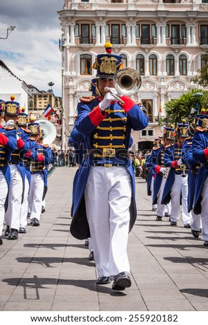 QUITO, ECUADOR - JAN 5, 2015: Unidentified Ecuadorian hussars march and make music during a parade in Quito 71,9% of Ecuadorian people belong to the Mestizo ethnic group - stock photo