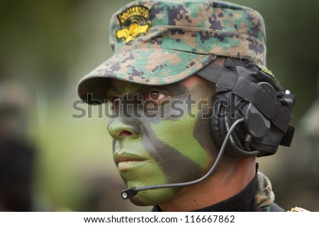 QUITO, ECUADOR- MAY 24 2012 National  military parade, unidentified camouflage  communications soldier with armo and military gear. May 24, 2012, Quito, Ecuador
