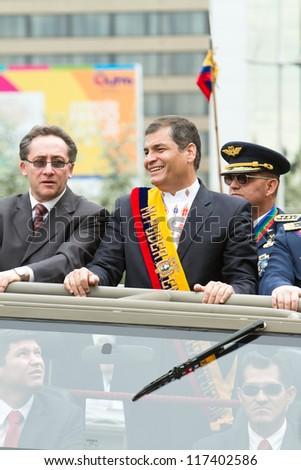 QUITO, ECUADOR- MAY 24 2012 National  millitary parade, Ecuador's President Rafael Correa  and minister on a military vehicle. May 24, 2012, Quito, Ecuador - stock photo