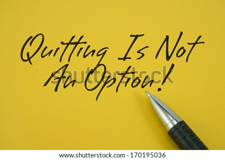 Quitting Is Not An Option note with pen on yellow background