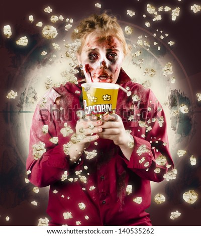 Quivering possessed girl watching horror movie at cinema in front row. B Grade Terror - stock photo
