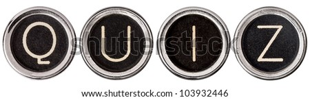 QUIZ spelled out in old, scratched chrome typewriter keys with black centers and white letters.  Isolated on white with clipping path. - stock photo