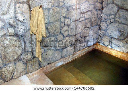 QUMRAN, ISR - SEP 27:Ancient mikvah on September 27 2007.It's a bath used for the purpose of the ritual immersion in Judaism according to the Jewish family purity law. - stock photo
