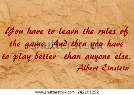 Quote by Albert Einstein on old paper background  - stock photo
