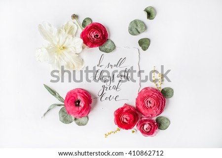 "quote ""Do small things with great love"" written in calligraphy style on paper with pink, red roses, ranunculus,   white tulips and green leaves isolated on white background. Flat lay, top view - stock photo"