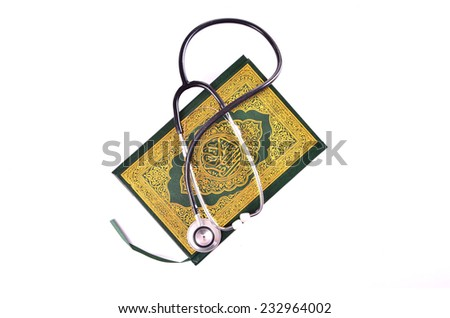 Quran with stethoscope. Concepts of medication and healthcare in islam - stock photo