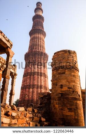 qutub minar, a sandstone monument  in delhi, India - stock photo