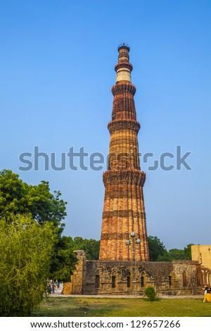 Qutub Minar Tower or Qutb Minar, the tallest brick minaret in the world , Delhi India. - stock photo