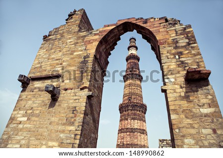 Qutub Minar Tower or Qutb Minar, the tallest brick minaret in the world, Delhi India. - stock photo