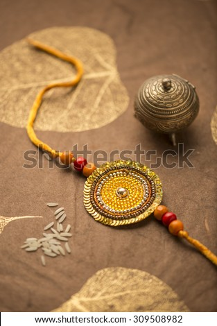 Raakhi - a traditional indian wrist band which is a symbol of love between brothers and sisters. - stock photo