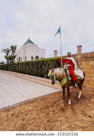 RABAT, MOROCCO - MAY 2 : Royal guard in front of the Hassan Tower and Mausoleum of Mohammed V. Mausoleum contains tombs of late King Hassan II and Prince Abdallah. On May 2, 2013 in Rabat, Morocco.
