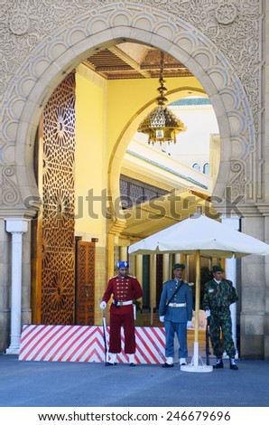 RABAT, MOROCCO - NOVEMBER 18: Unidentified soldiers as honor guard from different arms of service in front of the entrance to palace of King Hassan, on November 18, 2014 in Rabat, Morocco