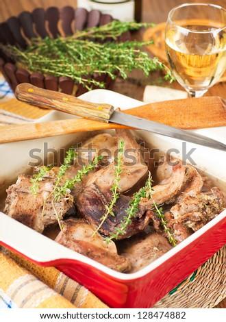 Rabbit stewed with white wine and herbs - stock photo